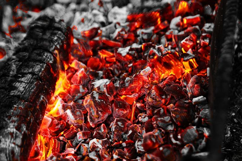Texture red hot coals, selective focus. Barbecue grill dark background.  stock images