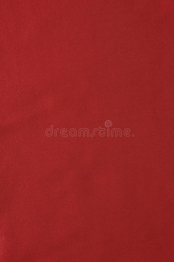 Texture of red nylon fabric - aviation tarpaulin close up royalty free stock photography