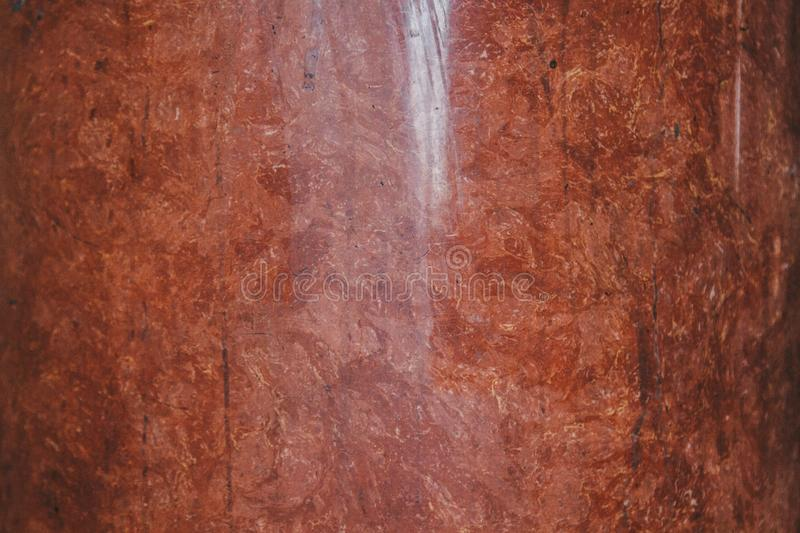 Texture of red and white marble stone close up. close-up layered rock structure stock photo