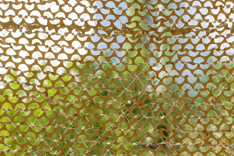 Texture redes da camuflagem das forças armadas na imagem do tempo do dia imagem de stock