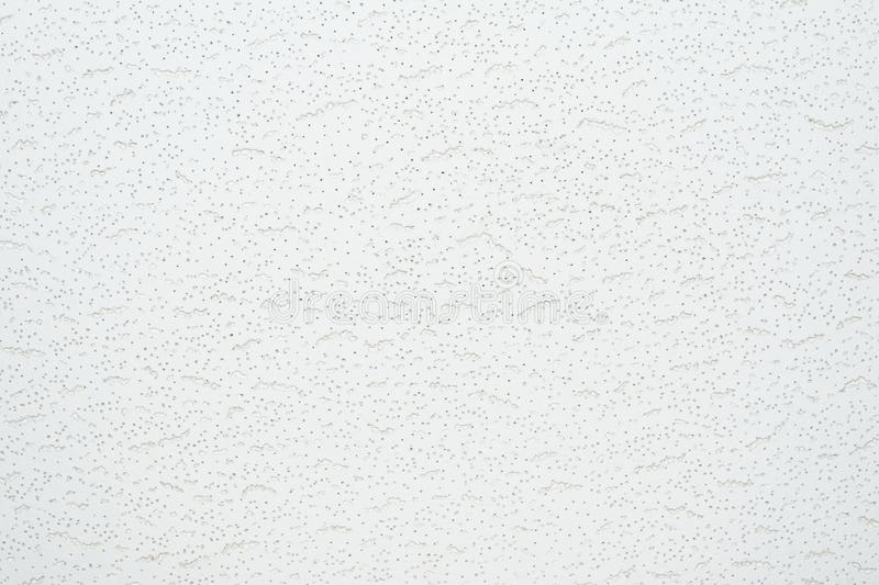 Texture of a relief white tile pendant or hem of a ceiling. Abstract background stock photography