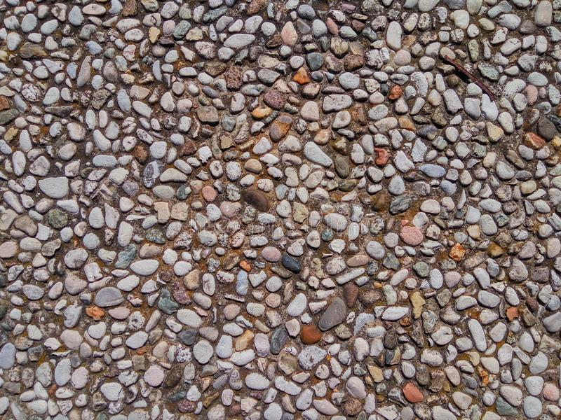 The texture of the road lined with small pebbles stock images