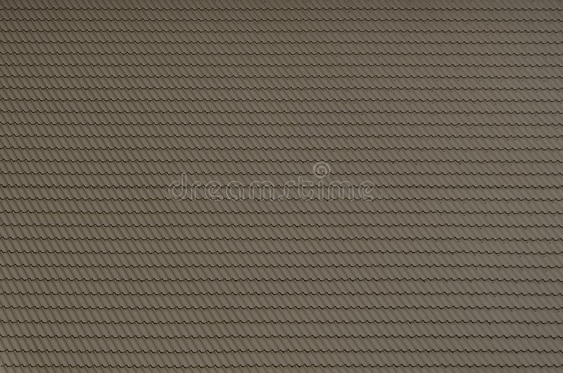 The texture of the roof of painted metal. Close-up detailed view of roof covering for pitched roof. High quality roofin. G royalty free stock photos