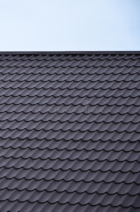 The texture of the roof of painted metal. Close-up detailed view of roof covering for pitched roof. High quality roofin. G stock photography