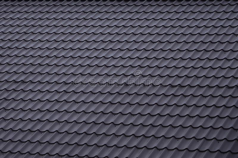 The texture of the roof of painted metal. Close-up detailed view of roof covering for pitched roof. High quality roofin. G stock photos