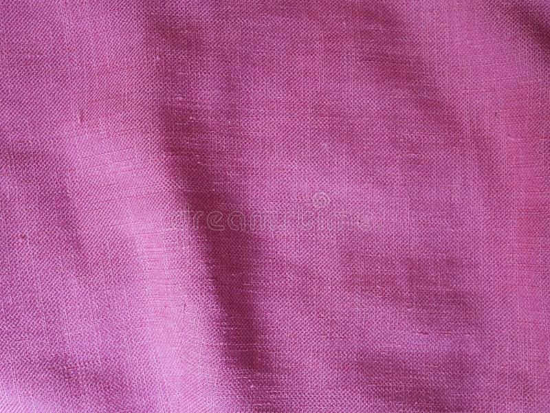 Texture rose de tissu de coton, fond en pastel de texture en soie rose images stock