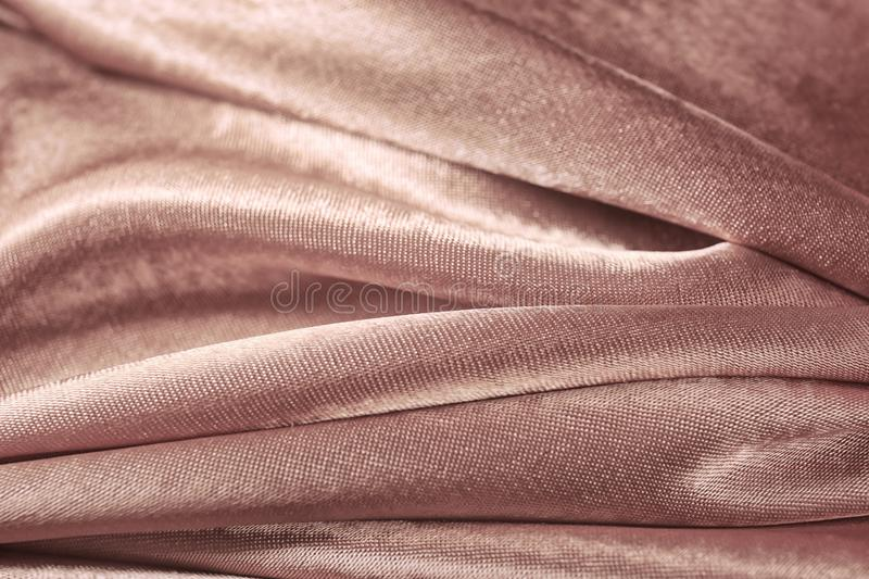 Texture of rose gold silk as background. Closeup stock images