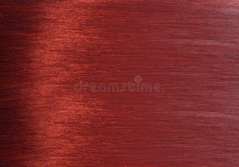 Texture rouge brillante de cheveux photo stock