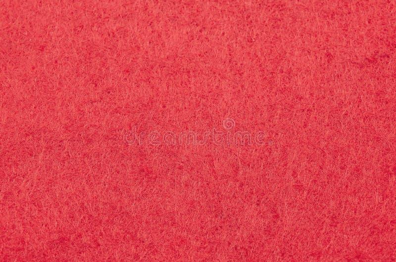 Texture rouge de fond de Noël de papier peint de tissu de feutre photos libres de droits
