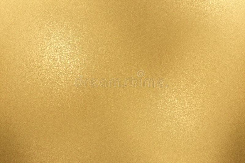 Texture of rough gold metallic sheet, abstract background.  royalty free stock photos