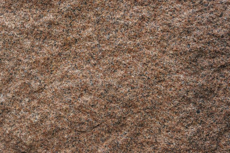 The texture of rough surface of red granite Close-up royalty free stock image