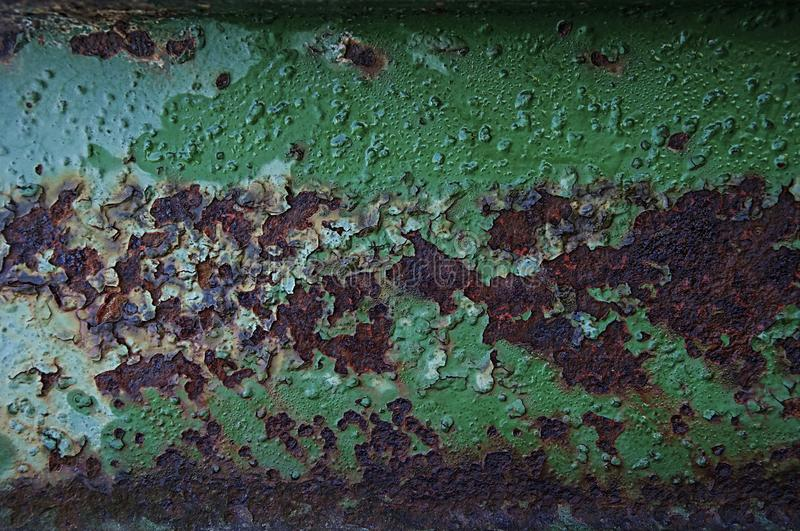 The texture of rust, against the background of green, bloated paint royalty free stock photos