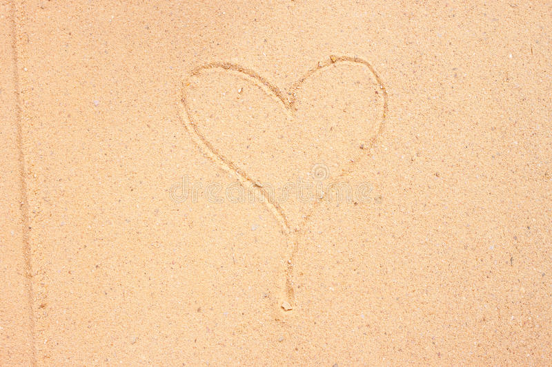 Texture of sand surface with heart. Detailed texture of sand surface with drawing of heart royalty free stock photos