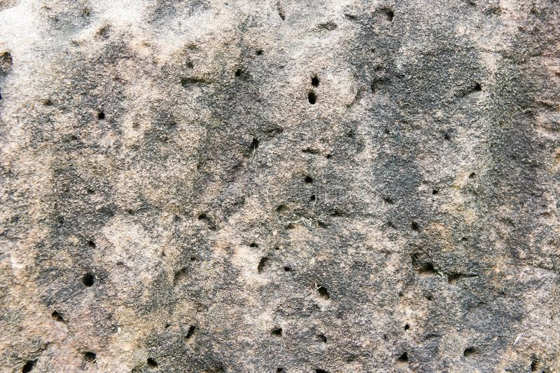 Texture Sandstone background Natural stone sandstone is characterized by large brown, solid, rough ground. stock photo