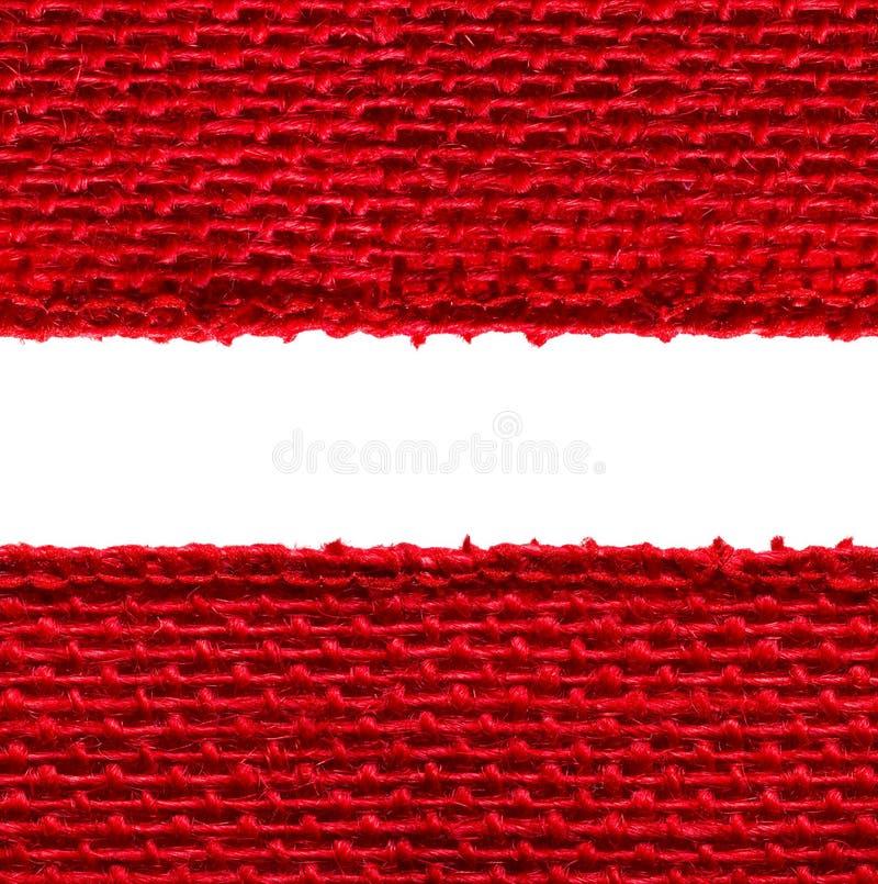 Texture sans couture de bord de tissu de toile de jute, renvoyant la frontière de tissu, rouge photographie stock libre de droits