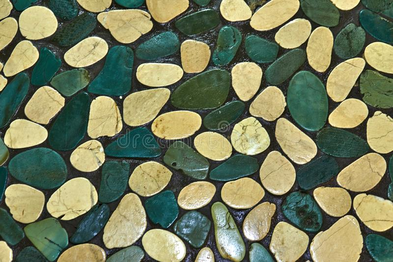 Texture of sea stones from light to dark green shades royalty free stock photo