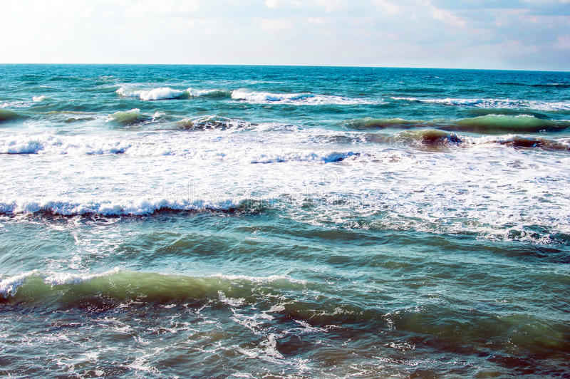 Texture - sea waves during a storm. In the daytime stock image