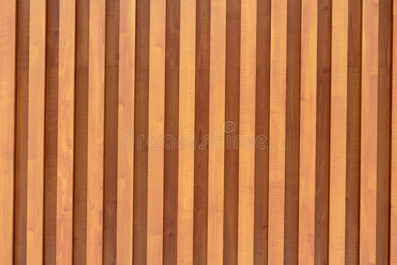 Texture of seamless wooden walls made of perpendicular slats royalty free stock image