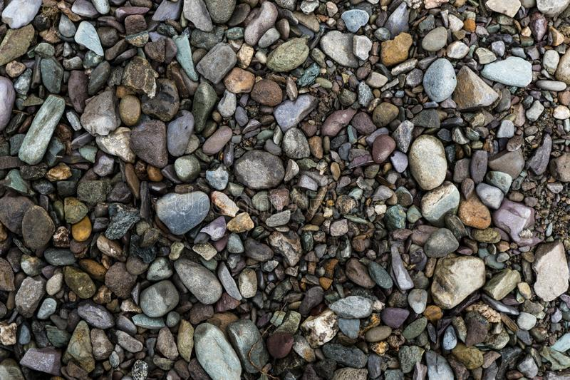 Pebble Background Image. The texture of a shallow river stone. Pebble Background Image royalty free stock image