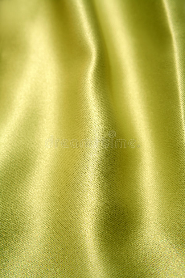 Texture and sheen of silk. A closeup view of the texture and sheen of fine silk fabric stock photo