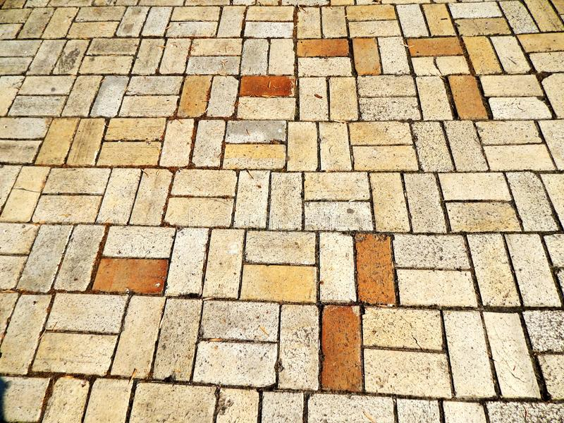 Texture of sidewalk tiles. Texture of yellow sidewalk tiles stock image