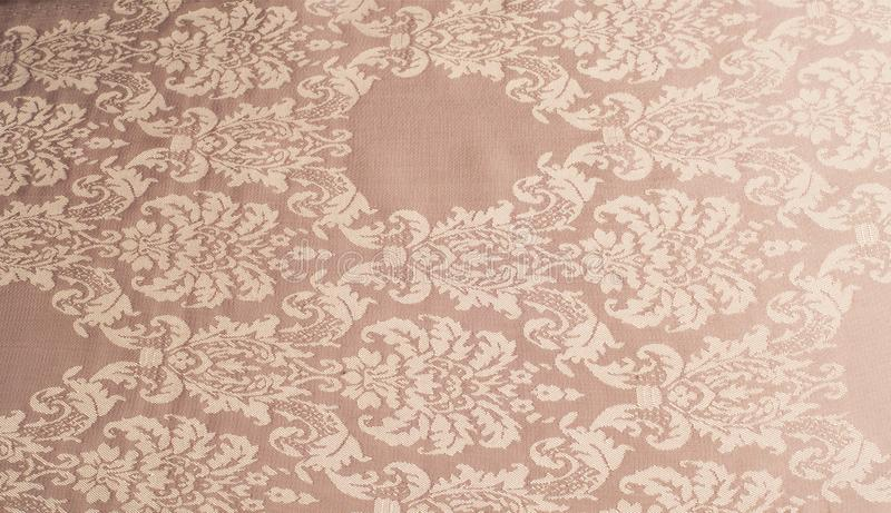 The texture of the silk fabric of beige with small white pattern stock images