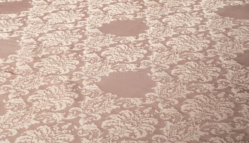 The texture of the silk fabric of beige with small white pattern. The texture of the silk fabric of beige with  small white pattern royalty free illustration
