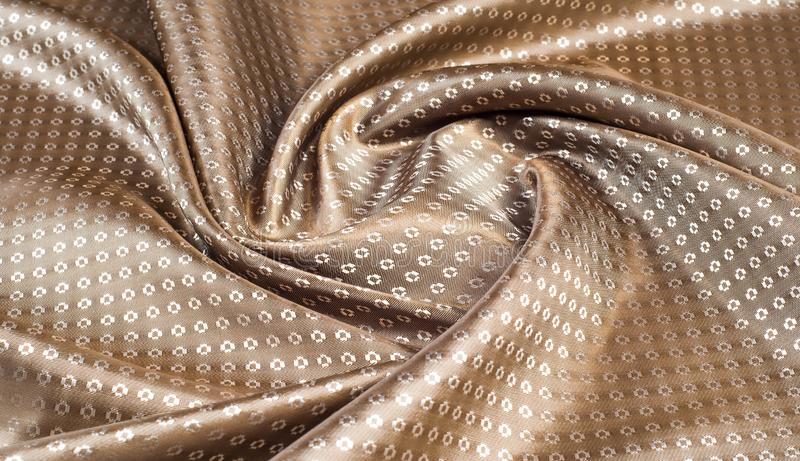 The texture of the silk fabric of beige with small white pattern. The texture of the silk fabric of  beige with small white pattern stock illustration