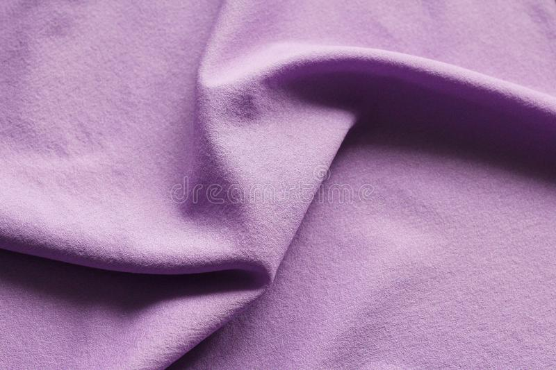 The texture of silk fabric. The material is pink stock photo