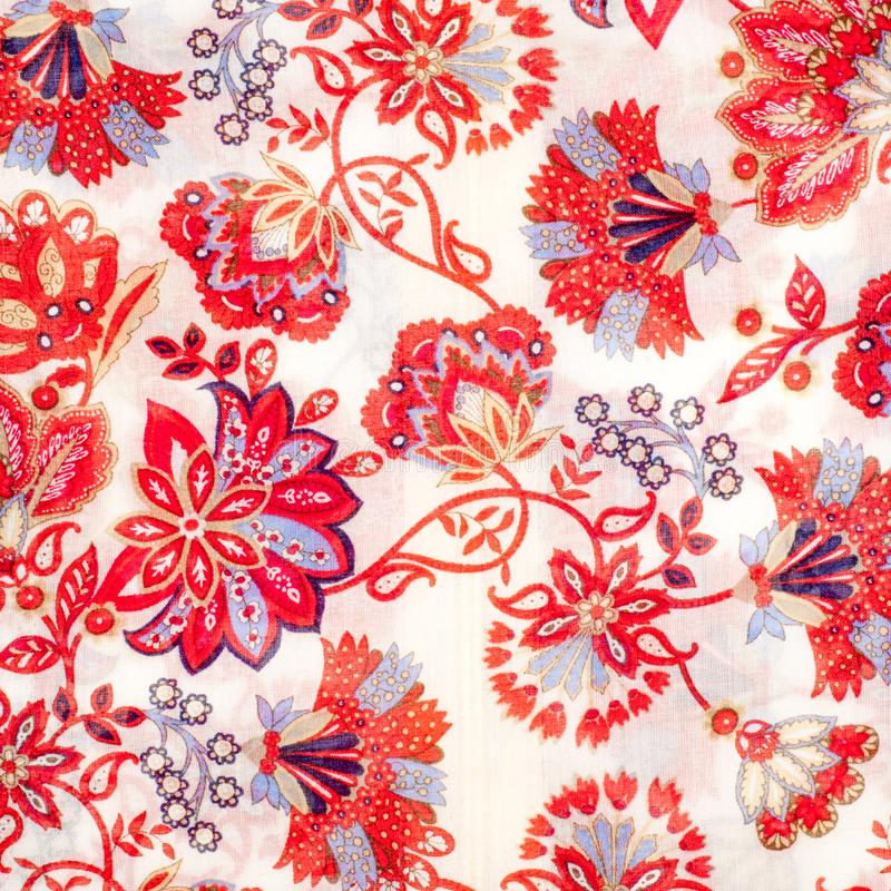 The texture of the silk fabric, red flowers on a white background royalty free illustration