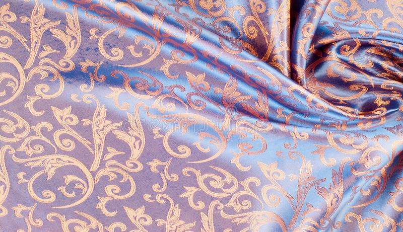 The texture of the silk fabric. Yellow Orange, Gold, Almond, Neon Carrot, a fine, strong, soft, lustrous fiber produced by silkworms in making cocoons and stock images