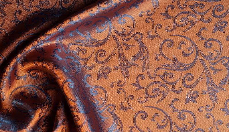 The texture of the silk fabric. Yellow Orange, Gold, Almond, Neon Carrot, a fine, strong, soft, lustrous fiber produced by silkworms in making cocoons and stock photo