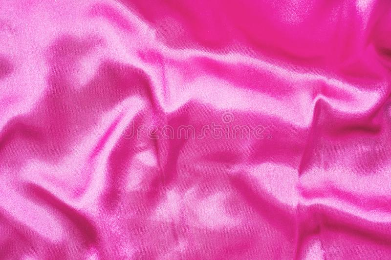 Texture of silk smooth fabric. Background of crimson material royalty free stock photos