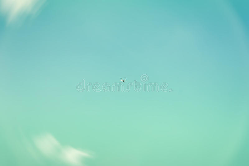 Texture of sky, beautiful turquoise or azure color, white fluffy clouds. High in the sky flies copter, drone royalty free stock photos