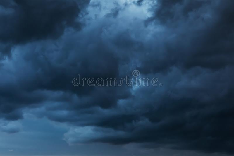Texture of the sky covered with dark rain clouds royalty free stock photography