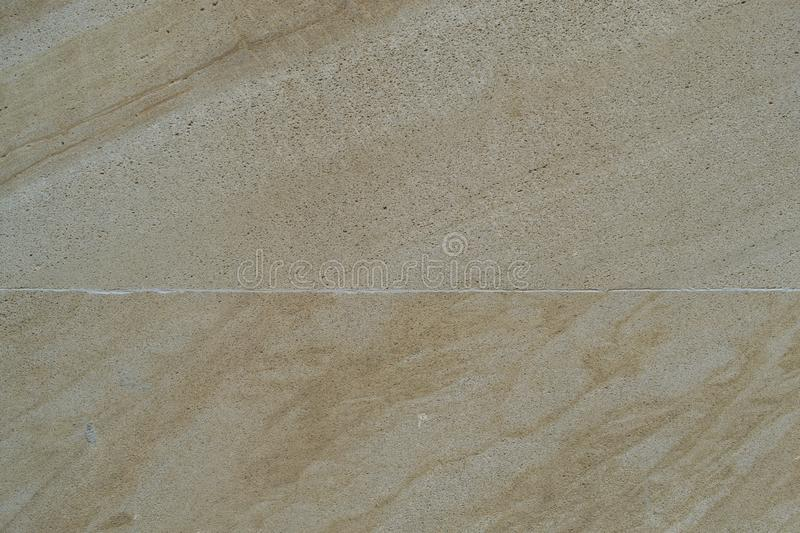 The texture is smooth marble, sand-coloured royalty free stock photo
