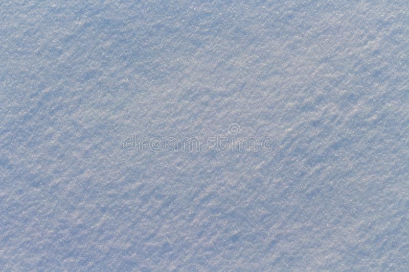 Texture of snow in blue light royalty free stock images