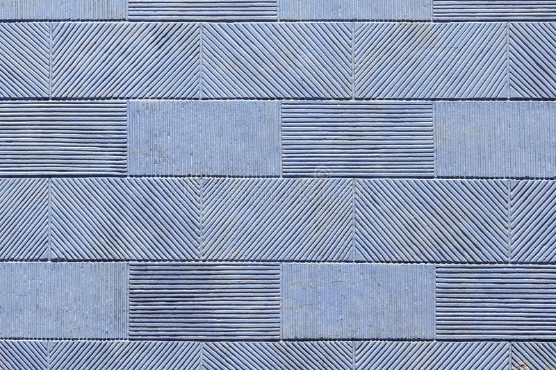 Texture stone tile. Texture of a wall from a stone tile, a striped pattern of a rectangular tile royalty free stock images