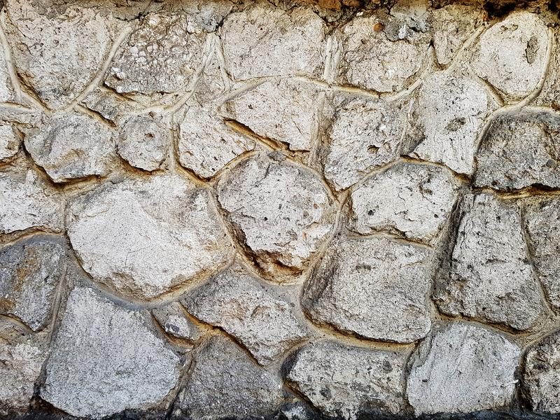 Texture of a stone wall. Old castle stone wall texture background. Stone wall as a background or texture. Part of a stone wall, fo stock image