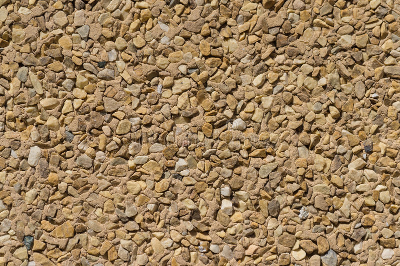 Texture stone wall wallcovering small pieces different stones. Wallcovering with small pieces of different stones texture stone wall stock photo