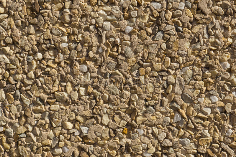 Texture stone wallcovering small pieces different stones. Wallcovering with small pieces of different stones texture stone wall shades high contrast royalty free stock image