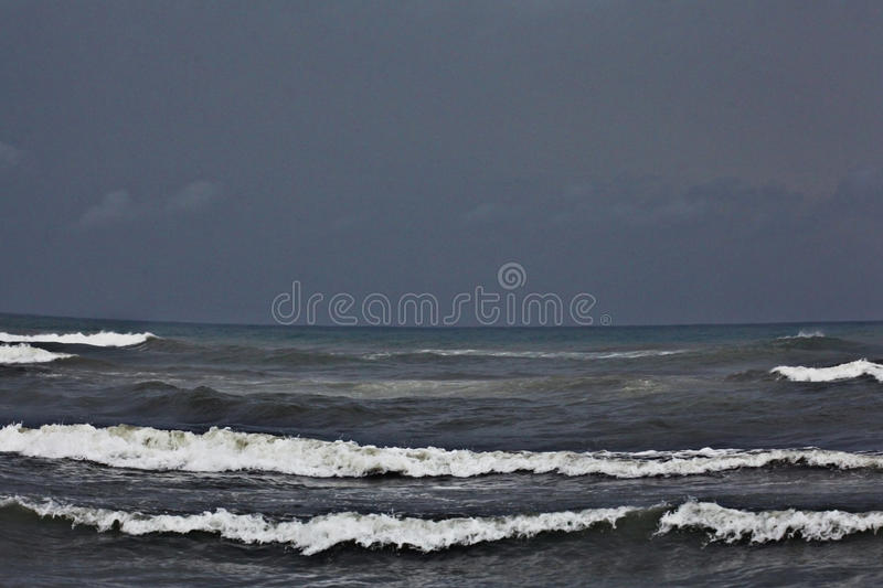 Texture of a storm at sea. Gray waves royalty free stock photography