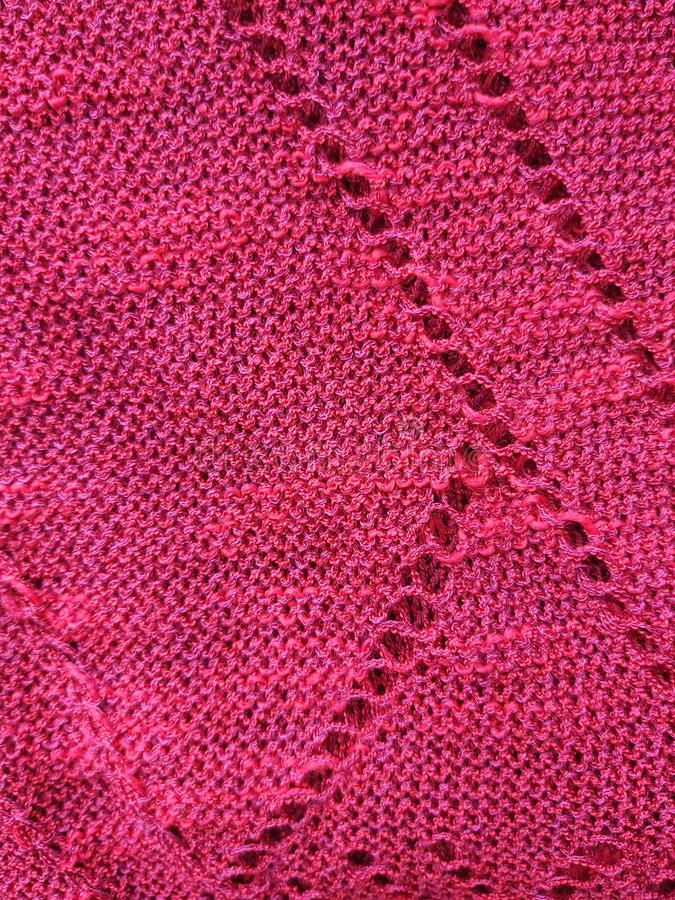 Texture of synthetic red knitted fabric for background stock photo