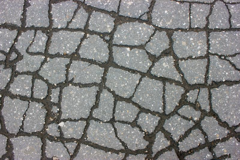 Texture of tarmac road with cracks - abstract background stock photography