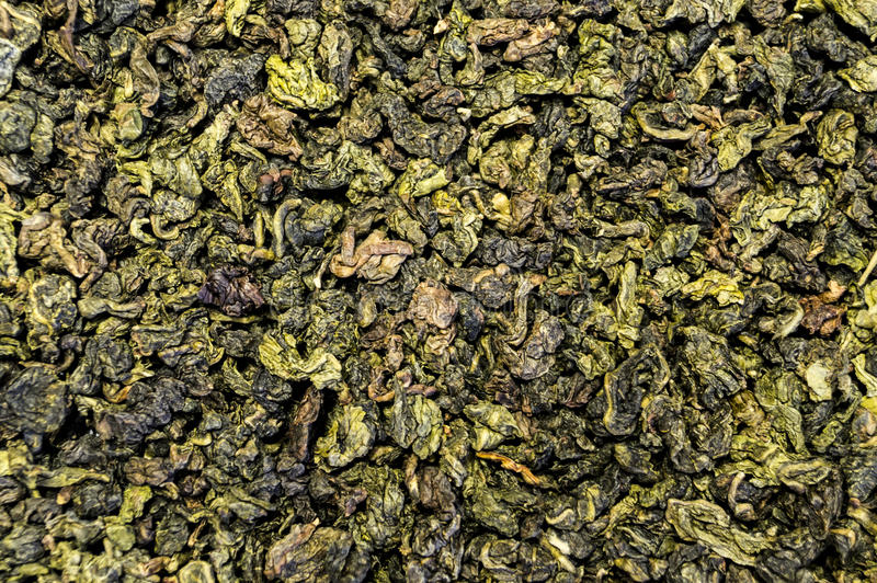 Texture of tea scattered on the table surface stock images