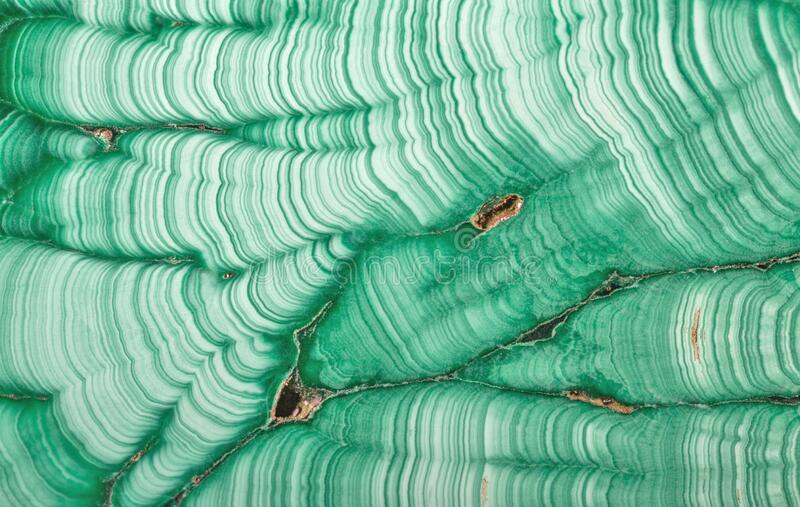Texture with thin waves of green malachite stock photo