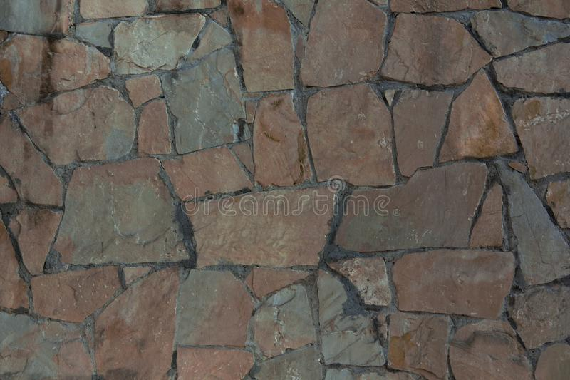 Texture of torn stone. Brown stone wall royalty free stock photo