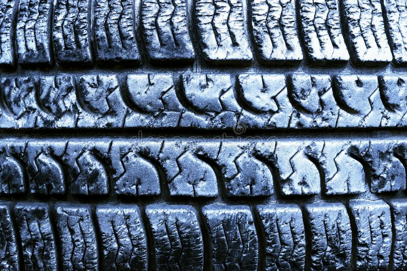 Texture of the tread wheel. Old tire close up. stock image