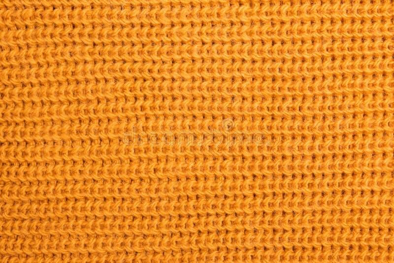 Texture tricotée de laine de couleur jaune lumineuse image stock