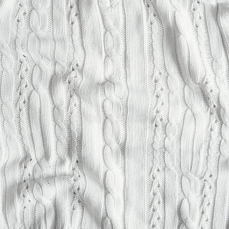 Texture tricotée ene ivoire blanche de tissu Texture faite main de chandail, fond, l'espace de copie images stock